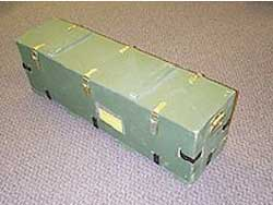 Missile boxes with tailor made dunnage and brass lid fasteners. Inspection holes are covered with plexiglass.
