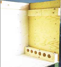 Clip-Lok box and dunnage for machine gun for fighter plane.