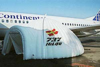 J B Roche's Igloo shelters are designed to extend above the wing - leaving sufficient height to fit the forward bootstrap equipment